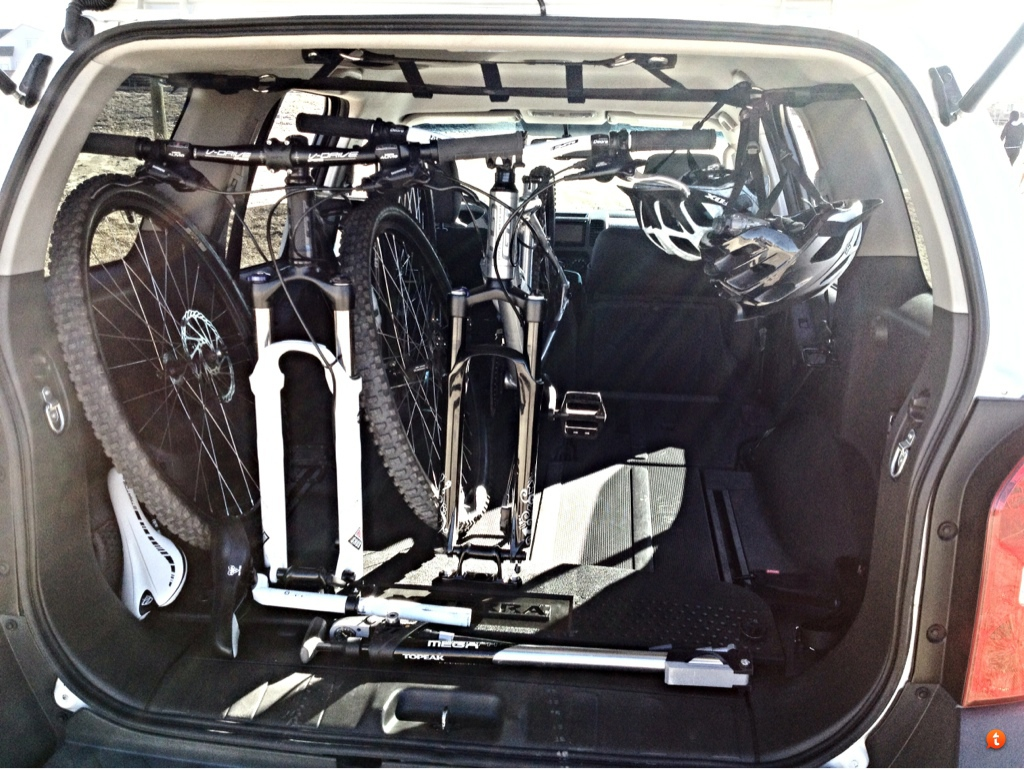 Does your mountain bike fit travel in your car 2008 xterra with 29er and a 26 with room to fold up the seat on the right if needed or room for another