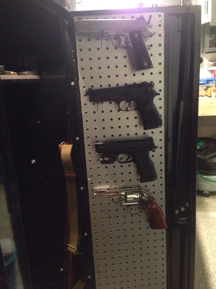 ... room in the cabinet for 6 pistols on the door. Already had stainless  look pegboard, bought 2