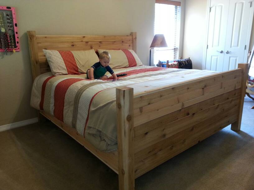 and a bed set so naturally we needed a new bed frame head board and foot board the frame is standard 2x4s and the posts are rough cut cedar 4x4s