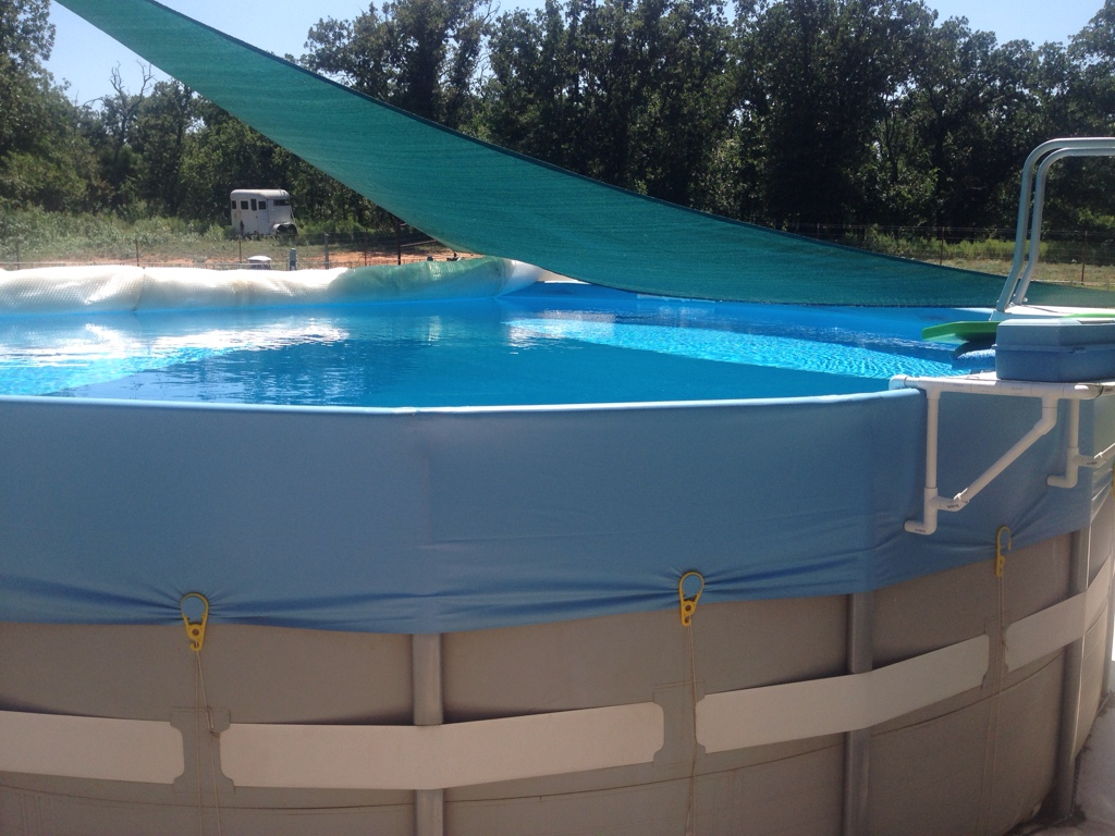at the end of the season i use algaecide 60 and cover the pool with a regular cover always clear when opening