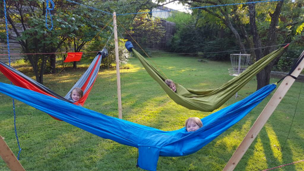well instead of asking me to build him a hammock he builds me the hammock stand out of the back  it is awesome  it holds three american size adults with     ultimate hang 3 person hammock stand   rh   hammockforums