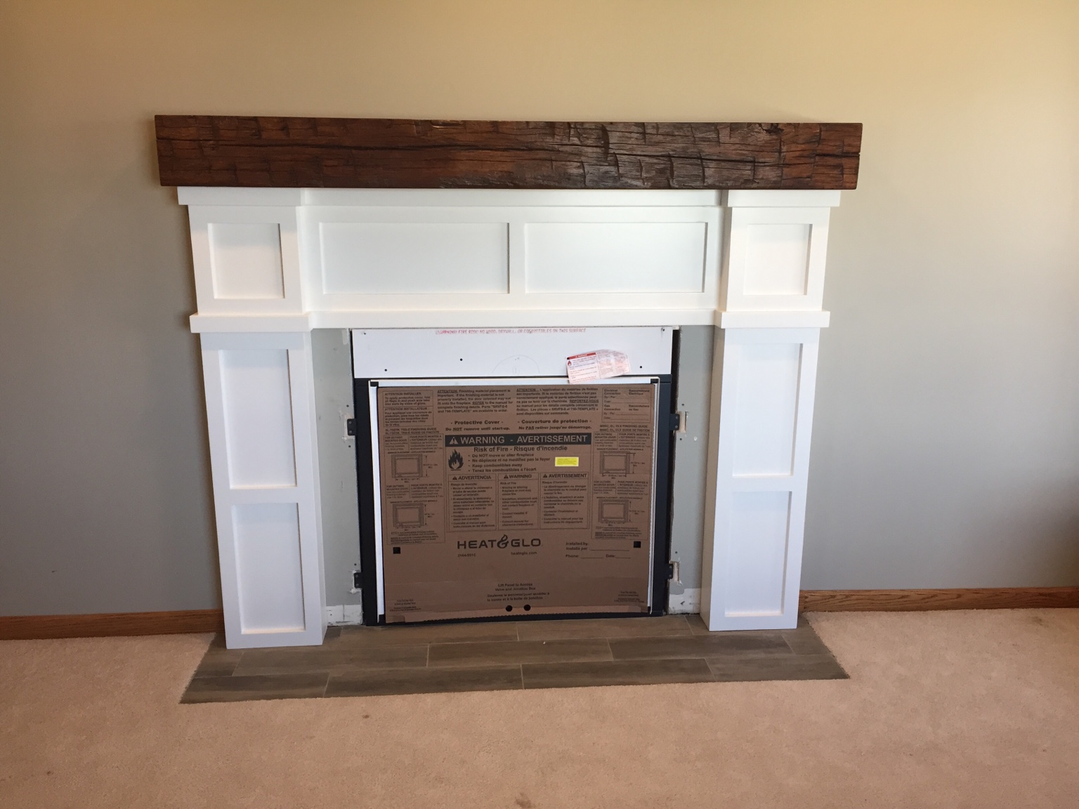This is a gas fireplace mantel I just got done doing. HO had this metal cut out and he will have it powder coated. Is there an adhesive you would recommend for attaching it?