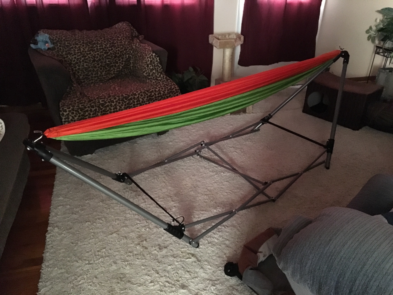 The folding hammock stand comes with a mesh hammock with spreader bars and  a carry bag for the whole thing with shoulder straps and a carry handle. - Gear Guide Folding Hammock Stand With Parachute Hammock.