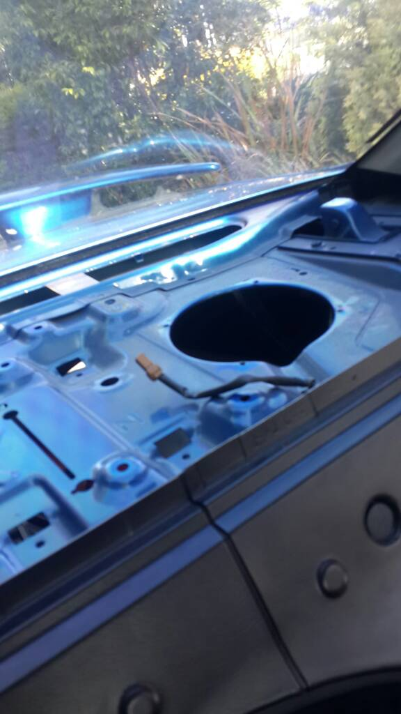 How do I remove rear parcel shelf for speaker change? \'99 pulsar sedan