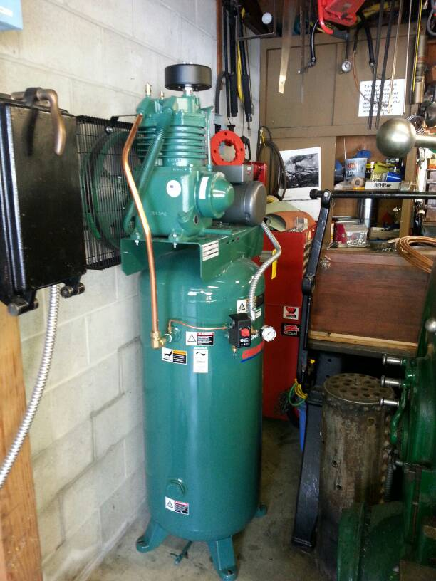 Quiet 2 3 hp air compressor i recently purchaced one made by gardner denver it is a low rpm with a five horse motor makes some noise but you can still have a conversation when its fandeluxe Choice Image