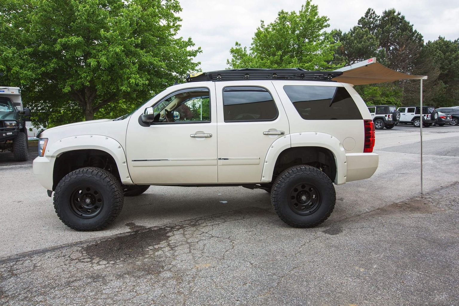 1101tr 2008 Chevy Tahoe Buildup additionally 0605tr Custom Chevy Avalanche besides Wheel Offset 2004 Chevrolet Tahoe Slightly Aggressive Leveling Kit Custom Rims in addition 0302or 2001 Chevrolet Suburban as well Page 40. on lifted tahoe z71