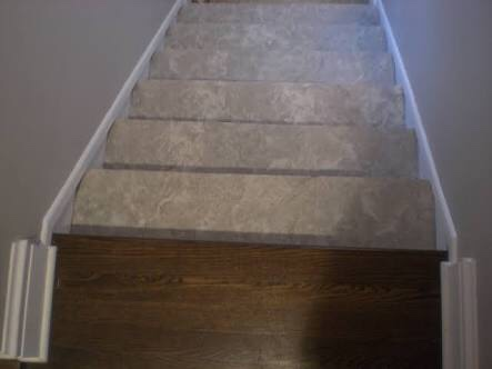 Tiles on stairs and timber on landing
