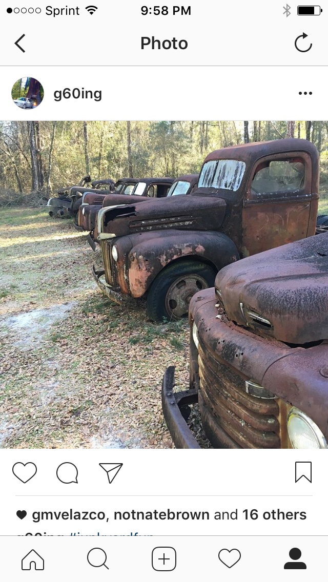 Trucks In Front Of Auto Salvage Building