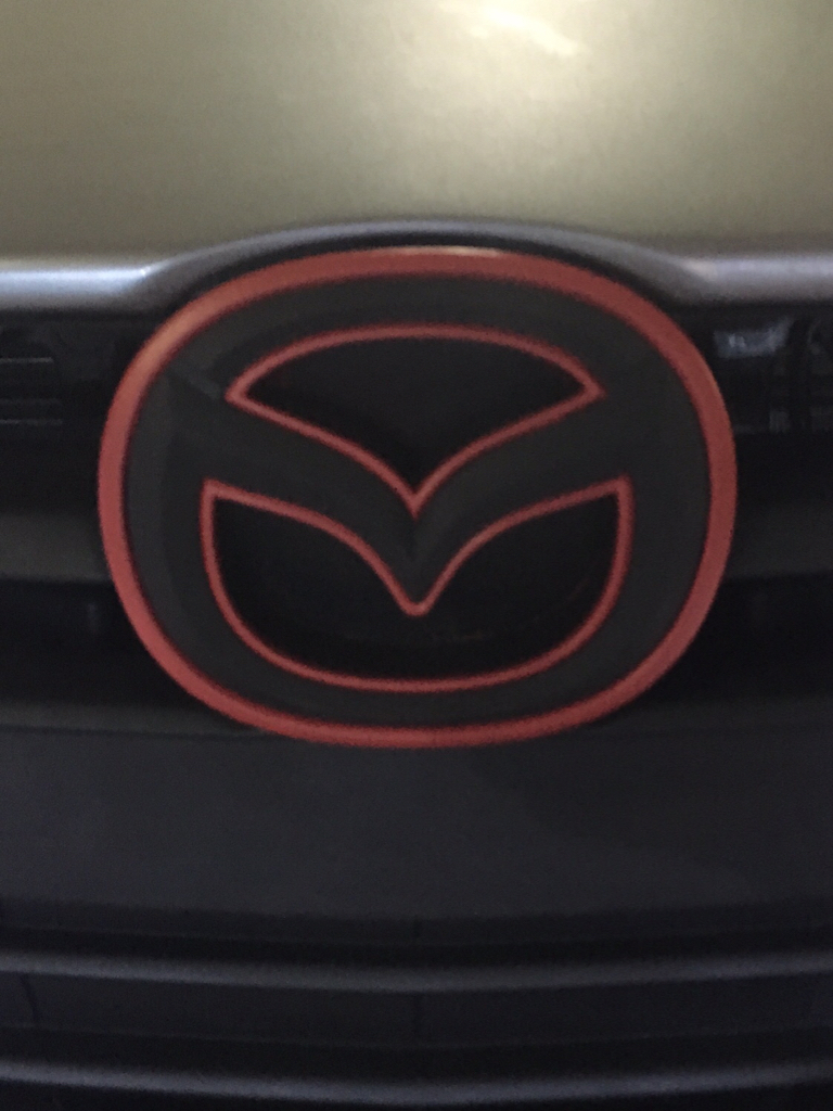 Diy dippingwrapping front emblem 14 page 8 2004 to 2016 anyway just sharing what i did with the front emblem i took out the emblem had the border wrapped in a red sticker plastidipped the mazda logo biocorpaavc Gallery
