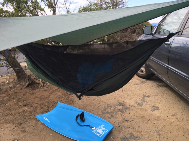 when positioning a car to hang from make more room  we were too close to the tree and fence when i switched over to bigger tarps  car camping at the beach  rh   hammockforums