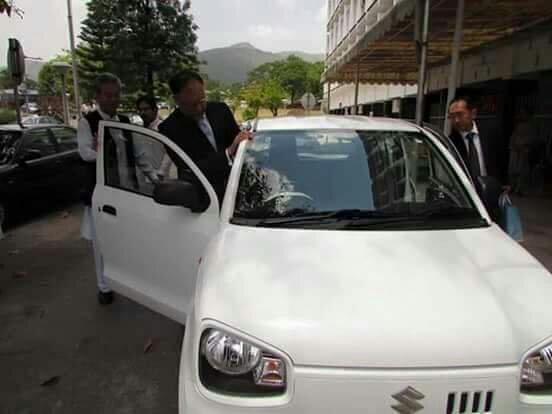 Ahsan Iqbal examining the new Suzuki Alto model to be launched by Suzuki Pakistan in  - 991749d74d452448ca65c21c16653f4a