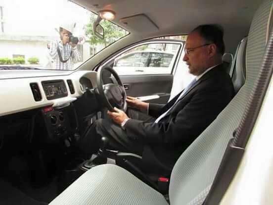 Ahsan Iqbal examining the new Suzuki Alto model to be launched by Suzuki Pakistan in  - d73a1c68148bca19c633db5c1b74a38e