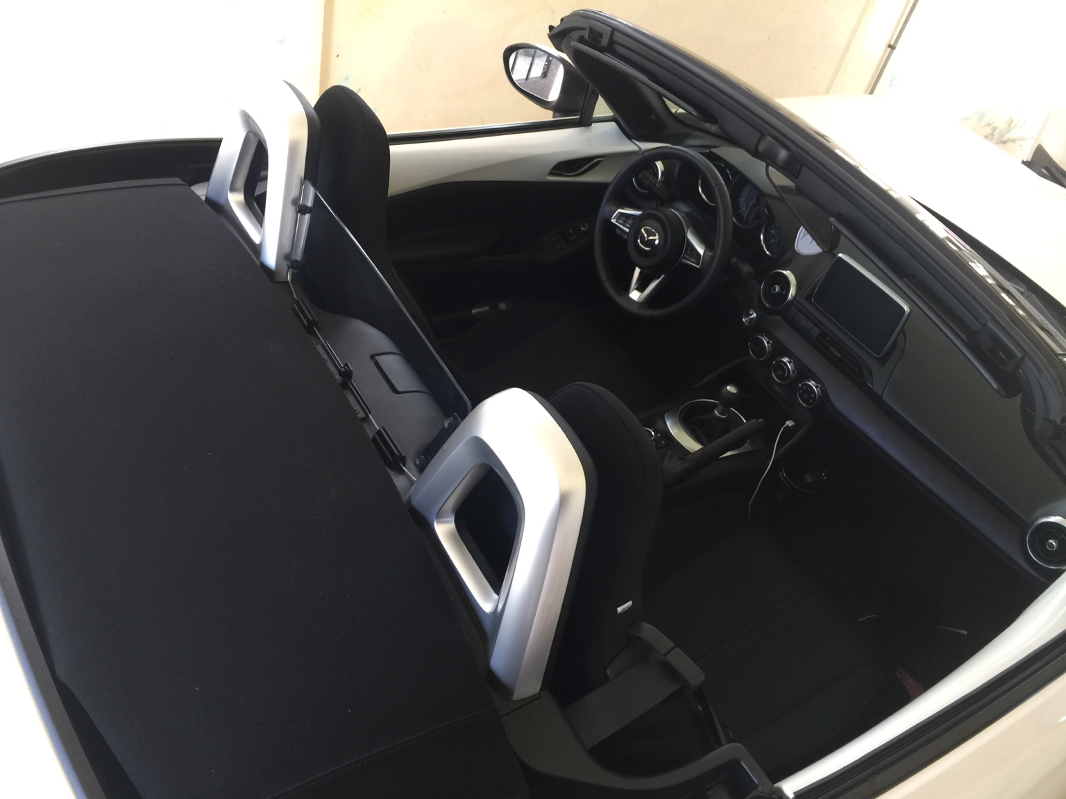 Mazda mx5 sunshade pictured with silver a c vents