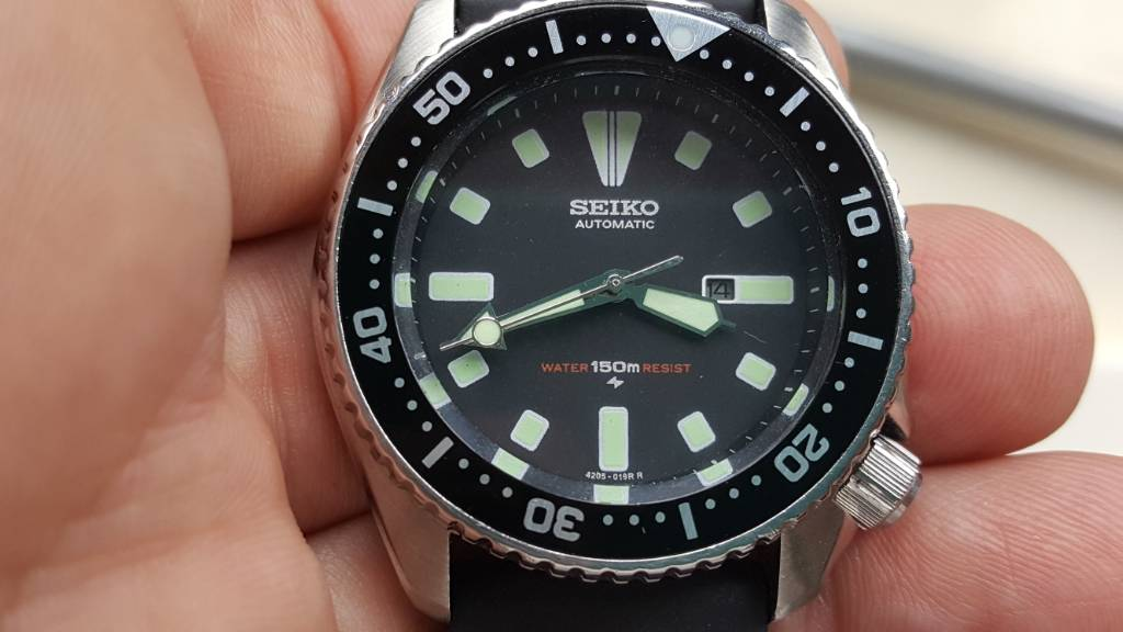 the case of the seiko 4205 0150 midsize diver fake dial hands and