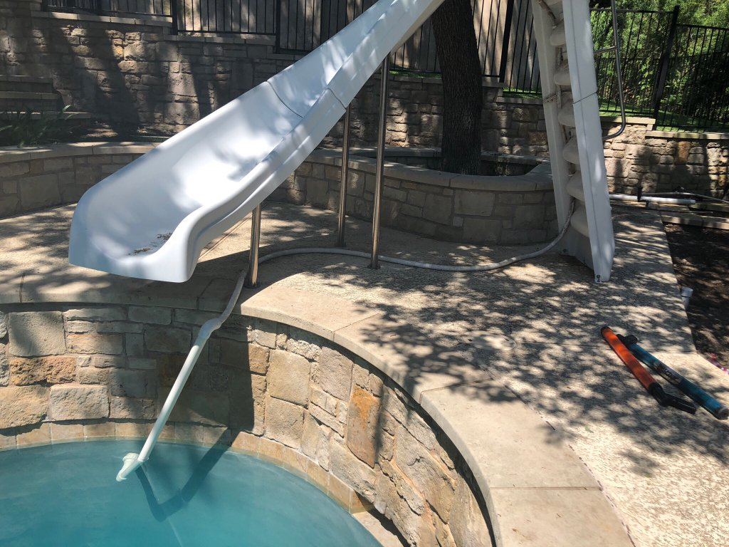 Cutting A Concrete Pool Deck To Bury A Pipe For Slide