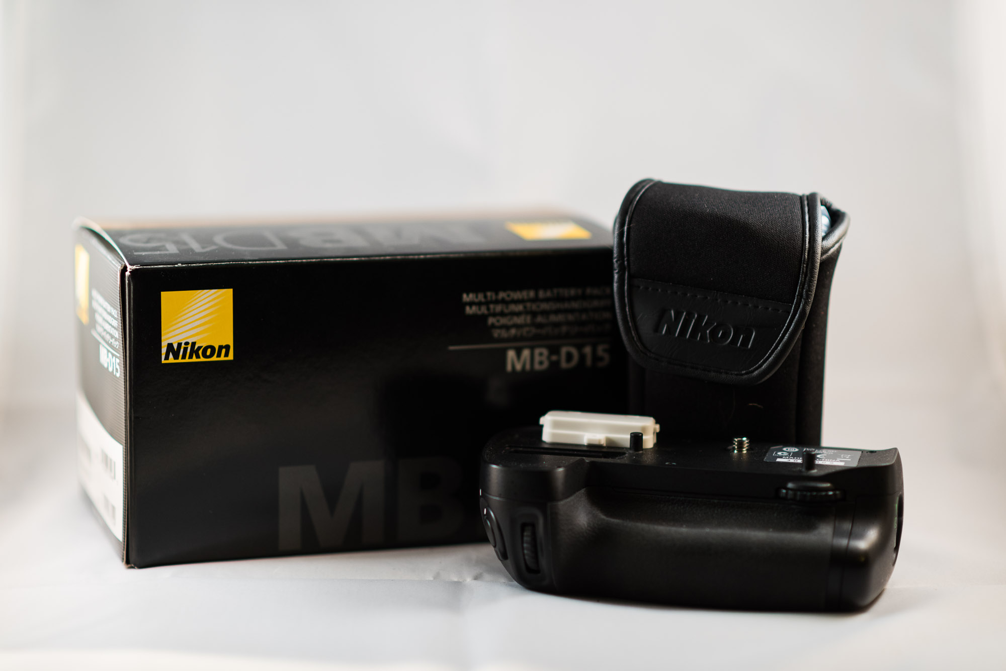 Nikon OEM battery grip for the D7100/7200 body. Includes both the AA and  EN-EL15 battery trays, plus the storage pouch. In box with original manuals.