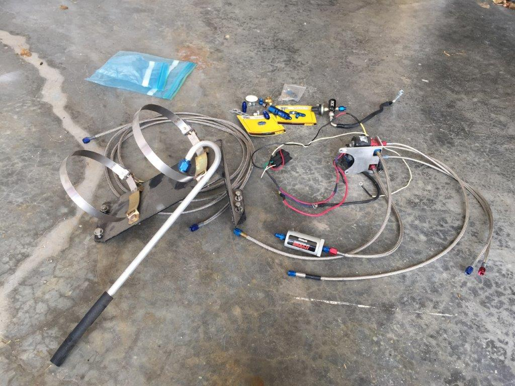 LX Specific NOS Solenoid bracket with solenoids, Trunk mount bottle bracket and parts